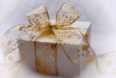 Present wrapped with beautiful bow Stock Photo
