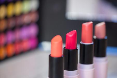 Close up photo of beautiful lipstick shades. Assortment of lipsticks. Selective focus