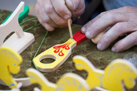 Ukraine, Lviv - October 14, 2018: Master class on making traditional West Ukrainian eco-toys. Banco de Imagens - 112107064