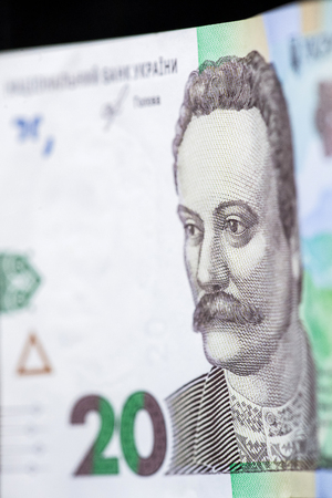 New banknote denomination of 20 UAH. Ukrainian money close up. Fragment of banknotes