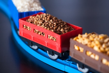Wagons with grain of buckwheat, rice and peas. Grain Cultures. Selective focus