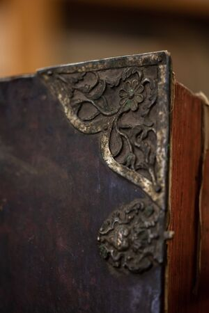 Large old leather book with metal corners. Old Vintage Rustic Book Corner