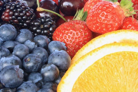 Berries and an orange, close up photo