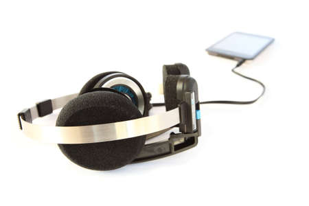 Headset and mp3 player on white photo