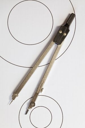 compasses: A pair of compasses on circles