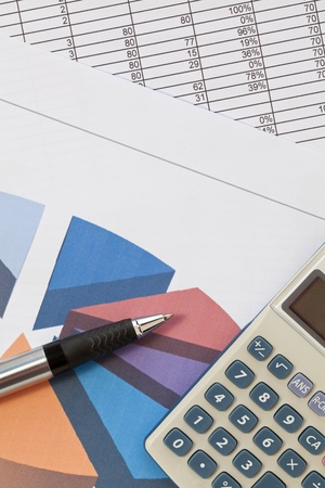 sales report: Calculator and pen on a chart