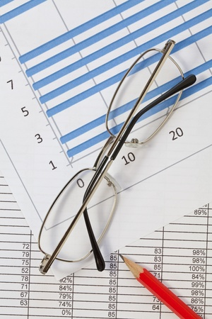Glasses and pencil on a spreadsheet Stock Photo