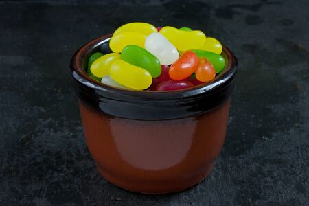 A bowl of jelly beans on a slate background Stock Photo - 11778280