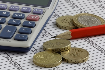 A pencil,Calculator   Pound Coins on a Spreadsheet with extended depth of field