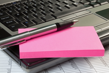 Laptop with spreadsheet,note pad and pen, with copy space