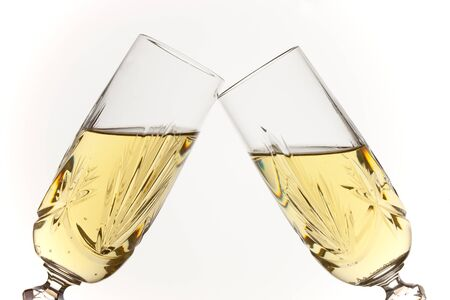 cutglass: Two glasses of vintage champagne raised in a toast