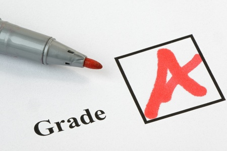 Grade A written on an exam paper, with pen. 36 mp image photo