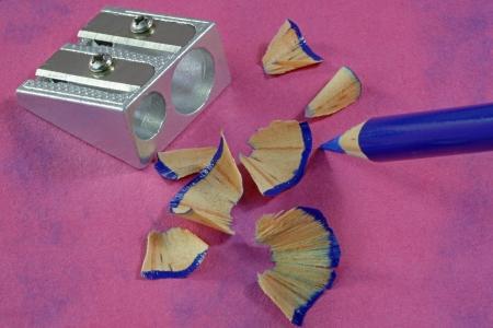 Crayon sharpenings with a sharpener and crayon photo