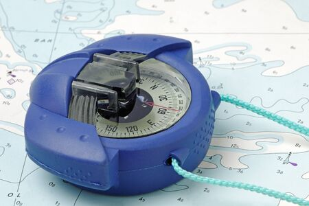 A marine hand-bearing compass on an old nautical chart - (chart is copyright free) photo