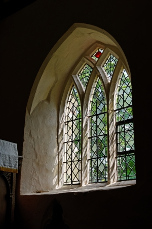 A leaded glass window in an English country church