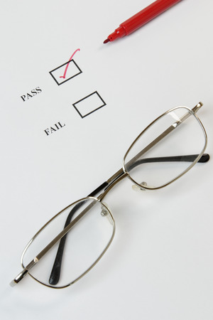 Quality control or exam check list with tick, red pen and glasses photo