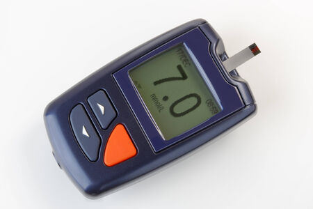 hypoglycemic: Close up of a blood glucose monitor  as used to test sugar levels in diabetics