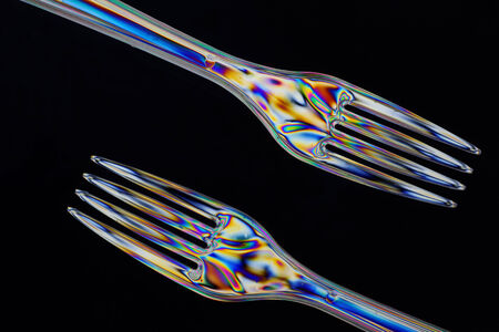 Plastic forks taken with double polarrised light in closeup photo