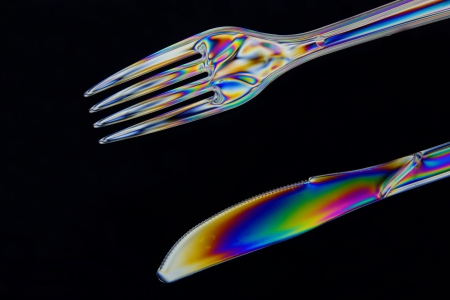 polarised: Plastic Knife and fork taken in double polarised light, in closeup