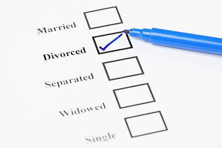 Tick-boxes showing marital status on a blank form. Divorced ticked. Stock Photo