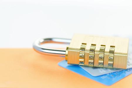 A padlock on credit cards. Card security concept.Shallow d o f. Banco de Imagens