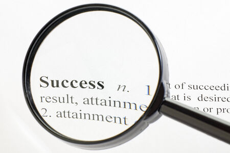 printing out: The word success seen through a magnifying glass Stock Photo