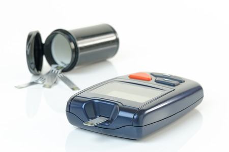 Blood glucose meter as used to monitor diabetes. Shallow d.o.f Stock Photo