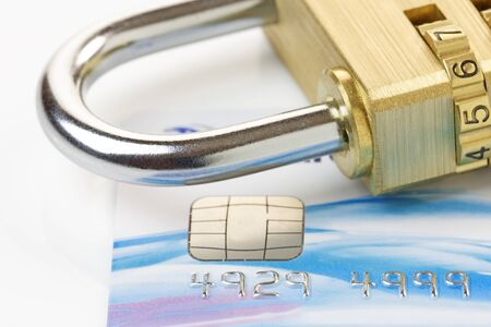 Close up of a credit or debit card with padlock. Card security concept. Card account number changed for security purposes. photo