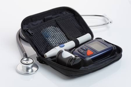 diabetes meter kit: A diabetic blood test kit, or glaucometer, in a case. Close up. Stock Photo
