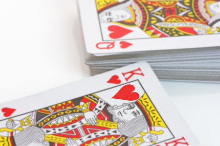 king of hearts: The King and Queen of Hearts on playing cards. Shallow d o f. ValentineLove concept Stock Photo