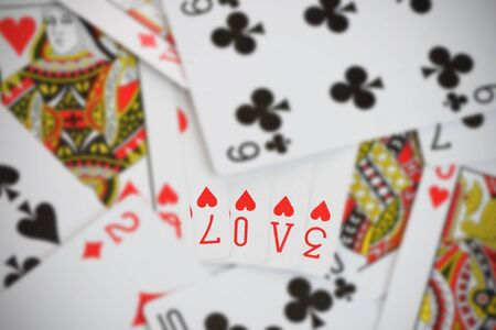 queen of hearts: The word Love made up from generic playing cards. Logos removed. ValentineLove concept