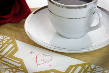 serviette: Heart drawn on a serviette with coffee cup and rose. LoveromanceValentines Day concept.