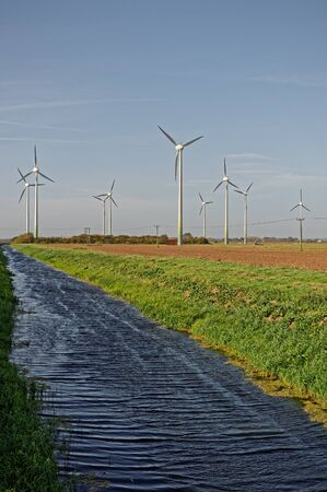 Wind turbines and drainage dyke in Lincolnshire,UK. HDR Image