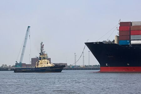 Tug and Container Ship in Harbor