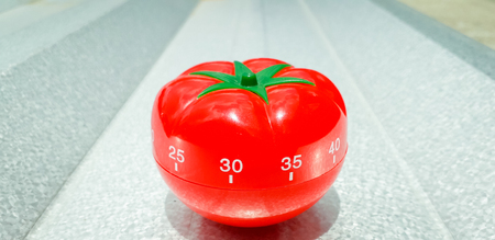 Pomodoro and a brushed metal with bold highlight and shadow. Stok Fotoğraf