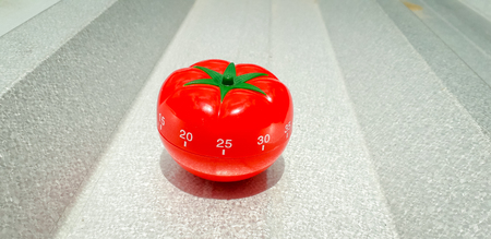 Pomodoro and a brushed metal with bold highlight and shadow. Stock Photo