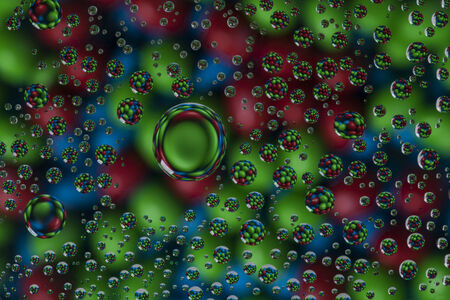 Candies in water droplets. Stok Fotoğraf