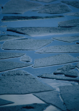 Broken chunks of Ice on a canal in Birmingham Stock Photo
