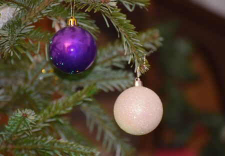 Christmas Baubles hanging from a tree