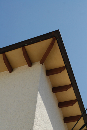 Looking up at the eaves of a roof