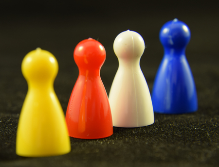Four colourful Game counters or playing pieces frm a childs game