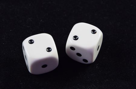 A pair white of dice showing Double Two