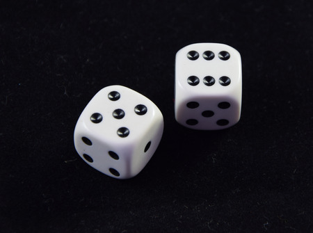 A pair white of dice showing Five and Six