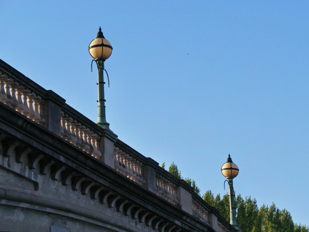 Street lamps on Reading Bridge on a sunny day Stock Photo
