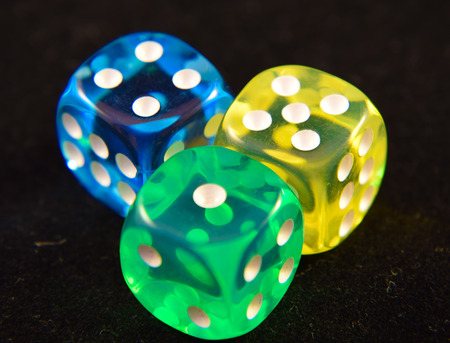 A collection of three colourful plastic dice