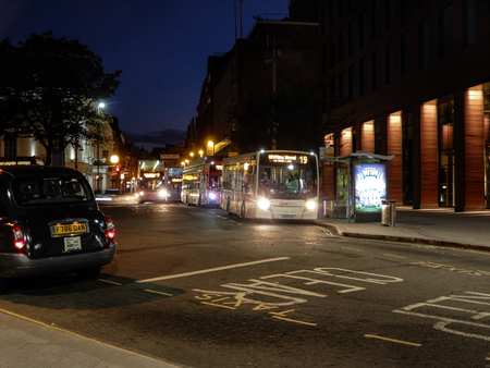 Reading Uk, 5th October 2017. Night Photo of the view down Station Road in Reading Town centre. Buses and a taxi are collecting passengers. Editorial
