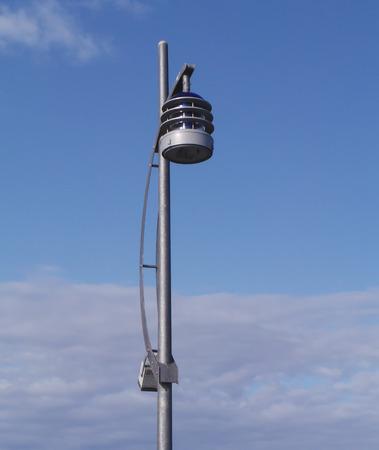 A modern lamp post agianst a blue sky