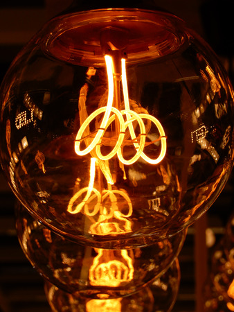 The glowing filament of an incancdescant light bulb