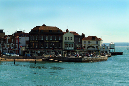 Portsmouth, England - July 06 2004:   A view across the water of the pubs on one side of Portsmouth Harbour