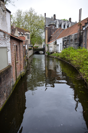 A canal winding through Bruges Stock fotó